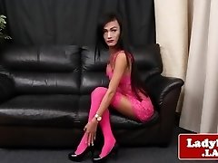 Lingeried ladyboy opens up arse and tugs solo
