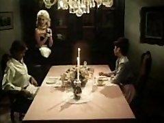 Vintage maid blows weenies under the table