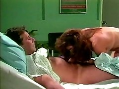 Dark haired lut hops on sausage of one patient in a clinic