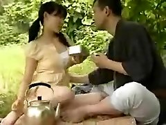 CHINESE YOUNG COUPLE PULVERIZING OUTSIDE