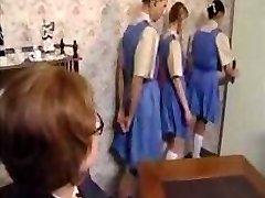 Naughty schoolgirls line up for their ass smacking punishment