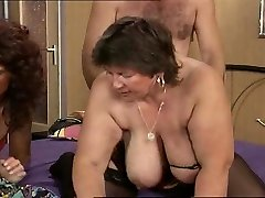 Grandmother with ample saggy tits gets it