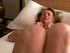 MILF wanks to orgasm