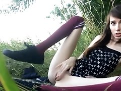 Sex Addict teen masturbates in the grass