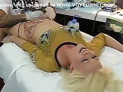 Blonde bimbo bellows with pain as her pubis was being tattooed
