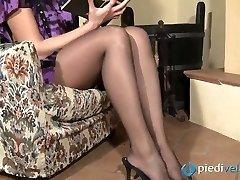 Wild brunette beauty Flavia looks irresistible in black nylon tights