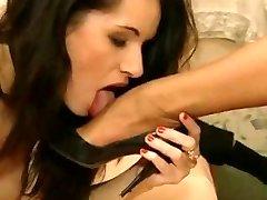 Laura Angel's high stilettos being licked