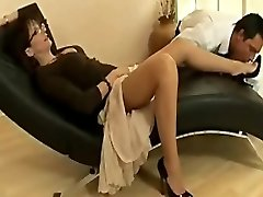 Sexy mature slut in nylons and heels teases a youthful boy