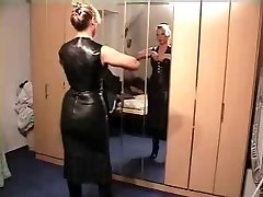 Female putting on leather clothes