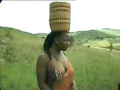 Africano de mierda safari para hombre blanco