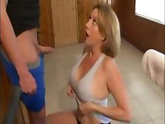 Busty mature babe gives this stiff dick a nice handjob for cum