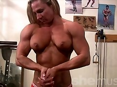 Woman Bodybuilder Unclothes in Gym