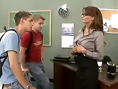 Busty brunette teacher fucks and fellates her two students in 3 way