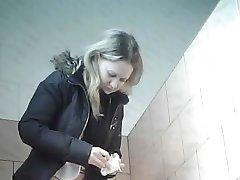 Peeping in women's restroom.
