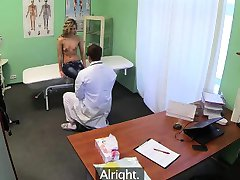 Petite blonde babe getting massaged by her doctor