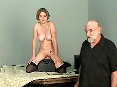 Short-haired b-cup blonde lowers her snatch onto mechanical dildo