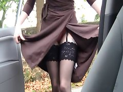 British slut Holly plays with herself in a layby in a car