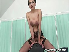 Brunette rides fucking machine
