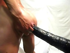 Giant dildo fucks me seen on side