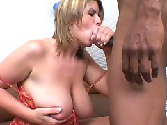 Hot young deep throat girl gives black guy a foot job, licks cum off her feet