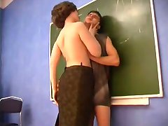 Teacher puts her hand into a young boys pants WF