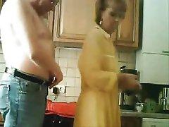 Mom and dad having fun in the kichten. Stolen video