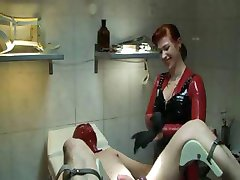 Mistress in latex is torturing her slave with some nasty toys