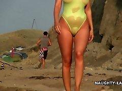 Sheer bikini and bare on the beach