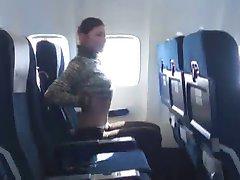 Brunette shows her boobs on plane
