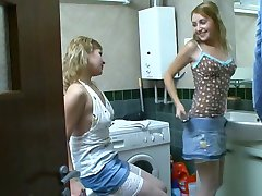 Sisters have fun in the bathroom. )