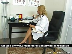 Busty blonde doctor in her office
