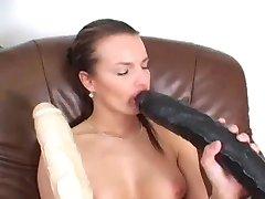 Brunette takes two giant dildos