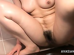 Horny Asian Masturbate Hard Her Slippery Pussy In The Bathroom