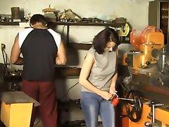 Brunette Gangbanged in Workshop