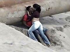 Latino pair caught on the beach