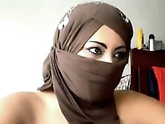 femeie arabă intermitent camera