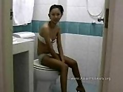 Thai Hooker Fellates Prick in the Toilet