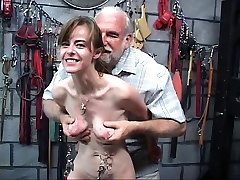 Skinny chick with weights hanging from her piercing