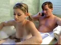 Father and stepdaughter having fun in bathroom