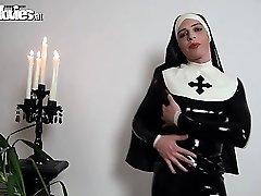 Bitchy latex nun rubbing her kinky latex costume