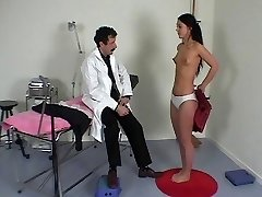 French doctor performs a utter physical exam