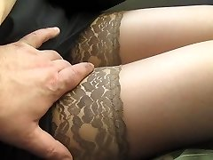 Kneading her gams in tan stockings in a bus