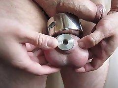 Transscrotal piercing