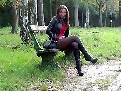 Julie skyhigh in leather attire hel bootsand belstaff trench