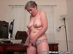 Old secretary Kelli strips off and fingers her furry pussy