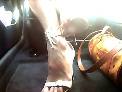 sexy feet & high heels in car