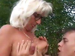 Grandma fucks younger guy outdoors
