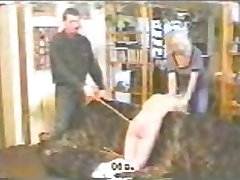 Blonde teen gets a hard caning on the couch