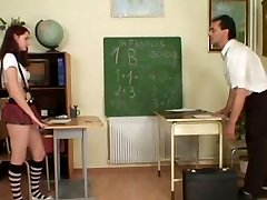 Rapacious teacher lures a steamy red-haired student to tongue fuck