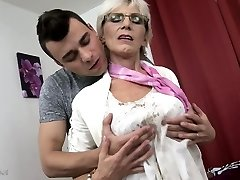 Horny granny with saggy tits fucked by a young guy